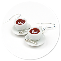 earrings white cups with coffee