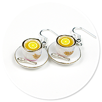 earrings cups with tea and lemon