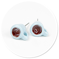 plug-in earrings with mug of coffee