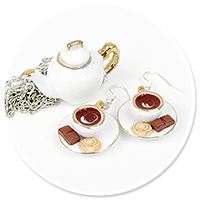 earrings cups and necklace with jug